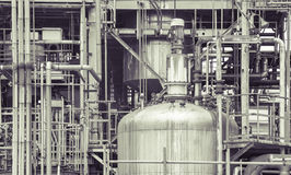 Oil refinery plant detail  in vintage tone edit Stock Image