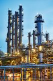 Oil refinery plant or factory. Of petroleum or petrochemical industry production at sunset stock photo