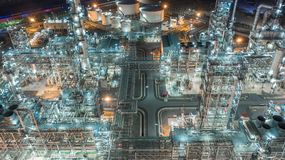 Oil refinery plant form industry zone, Aerial view oil and gas industrial, Refinery factory oil storage tank and pipeline steel at. Night stock photography