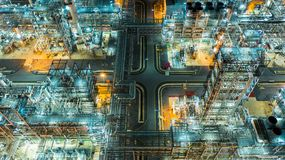 Oil refinery plant form industry zone, Aerial view oil and gas industrial, Refinery factory oil storage tank and pipeline steel at. Night stock photo