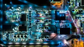 Oil refinery plant form industry zone, Aerial view oil and gas industrial, Refinery factory oil storage tank and pipeline steel at. Night royalty free stock images
