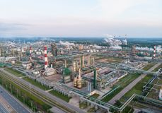 Oil refinery plant industry, Refinery factory, oil storage tank and pipeline steel with sunrise and cloudy sky. Background, Russia stock photography