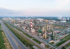 Oil refinery plant industry, Refinery factory, oil storage tank and pipeline steel with sunrise and cloudy sky. Background, Russia royalty free stock images