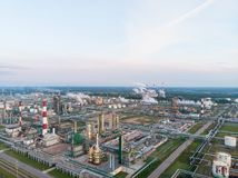 Oil refinery plant industry, Refinery factory, oil storage tank and pipeline steel with sunrise and cloudy sky. Background, Russia royalty free stock image