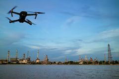 Oil refinery plant near river and drone stock photography