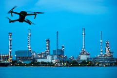 Oil refinery plant near river and drone. Modern RC Drone / Quadcopter with camera flying on Oil refinery plant site. double exposure Stock Photo
