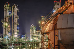 Petrochemical with night. Oil refinery plant with night, Gas storage tank in petrochemical plant at night time Stock Images