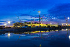 Oil refinery plant night scene nearby river in Thailand Stock Images
