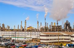 Oil refinery plant with parking, offices and smoking pipes Royalty Free Stock Photography