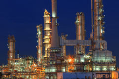 Oil refinery plant in petrochemical industry estate at night tim Royalty Free Stock Photo