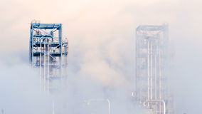 Oil refinery plant of petroleum or petrochemical industry production in smoke stock video footage