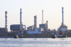 Oil refinery plant beside river in morning light Stock Images