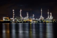 Oil refinery plant while twilight Stock Photo