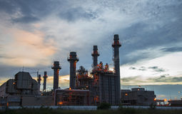Oil refinery plant at twilight with sky background stock images