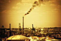 Oil refinery polluting the atmosphere Royalty Free Stock Photo
