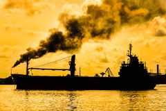 Oil refinery polluting the atmosphere Stock Photography