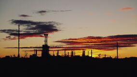 Oil refinery. Power and energy. Timelapse. Sunset time