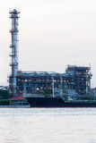Oil refinery power plant river front Stock Images