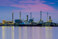 Oil refinery reflected along with river Royalty Free Stock Photos