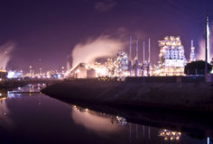Oil refinery river Stock Images