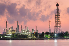 Oil refinery river front during sunrise Stock Photography