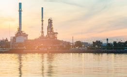 Oil refinery river front with sunset sky royalty free stock photo