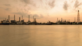 Oil refinery riverfront during sunrise Royalty Free Stock Photo
