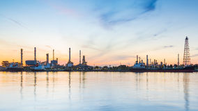 Oil refinery riverside with sunrise sky background Stock Photography
