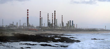 Oil refinery by the sea Stock Photography