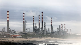 Oil refinery by the sea Royalty Free Stock Photo