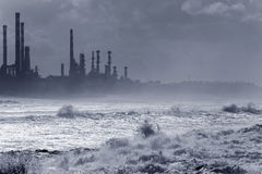 Oil refinery by the sea Royalty Free Stock Images
