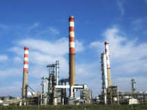 Oil refinery with several towers. Stock Image