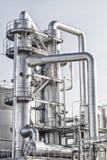 Oil refinery shiny tubes Royalty Free Stock Photos