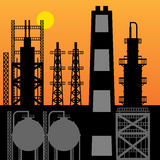 Oil refinery silhouette at sunset Royalty Free Stock Photos
