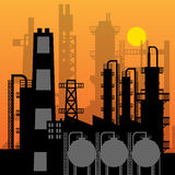 Oil refinery silhouette at sunset Royalty Free Stock Image