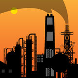 Oil refinery silhouette at sunset Stock Image