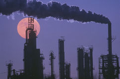 An oil refinery silhouetted Royalty Free Stock Photos