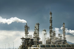 Oil refinery with smoke Royalty Free Stock Images