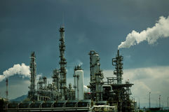 Oil refinery with smoke Royalty Free Stock Image