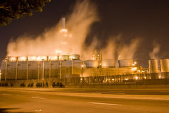 Oil refinery and smoke. An oil refinery in the United States with a series of foggy and smoky stacks. Smoky mist rising from the main center of the industrial Stock Photos