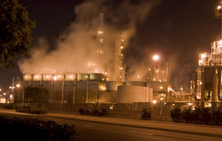 Oil refinery & smoke rising Royalty Free Stock Photo