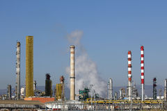Oil refinery smoke stacks Stock Image