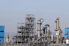 Oil refinery smoke stacks Stock Images