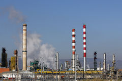 Oil refinery smoke stacks Royalty Free Stock Photos
