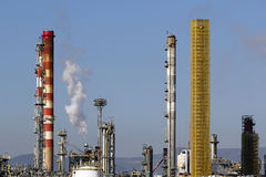 Oil refinery smoke stacks Royalty Free Stock Image