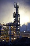 Oil refinery with steam Stock Image