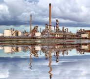 Oil refinery with storm clouds Stock Photography