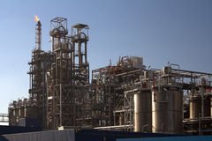 Oil refinery in a sunny day Stock Photos