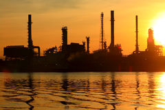 Oil refinery with sunrise Stock Photo
