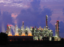 Oil refinery at sunrise Stock Photos